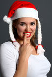Santa Girl With Finger In Mouth Stock Photos