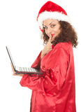 Santa girl with working on laptop Royalty Free Stock Image