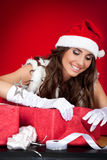 Santa girl wrapping xmas present Royalty Free Stock Photography