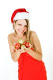 Santa girl with xmas balls in hands Royalty Free Stock Photo