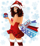 Santa girl with xmas gift and shopping bags Royalty Free Stock Photo