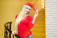 Santa girl. Young model with santas cap Royalty Free Stock Images