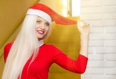 Santa girl. Young model with santas cap Royalty Free Stock Photography