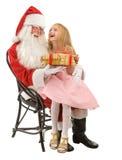 Santa Gives en flicka för gåva lite royaltyfri fotografi