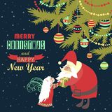 Santa gives a gift to little angel. Vector greeting card Stock Images