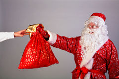 Santa gives gifts Royalty Free Stock Photo