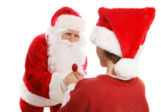 Santa Gives Lollipop to Boy. Santa Claus giving a lollipop to a young boy. White background royalty free stock photo