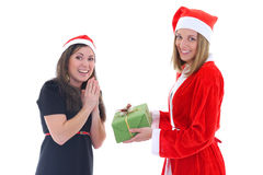 Santa gives present for happy girl Royalty Free Stock Image