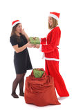 Santa gives present for happy girl Royalty Free Stock Photography