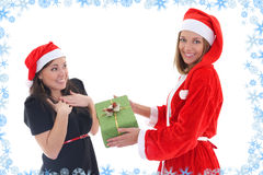 Santa gives present for happy girl Stock Photo