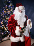 Santa Giving. Santa putting train in giant stocking royalty free stock images