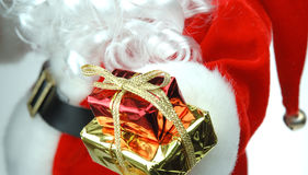 Santa Giving. Santa and presents Royalty Free Stock Photography