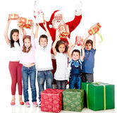 Santa giving Christmas gifts Royalty Free Stock Photos