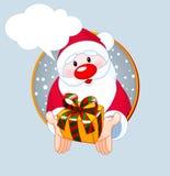 Santa  giving a gift card Royalty Free Stock Photos