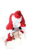 Santa is giving gift to sleeping baby Royalty Free Stock Photography