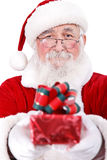 Santa giving present for Christmas Stock Photos