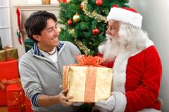 Santa giving a present to a man Stock Photo