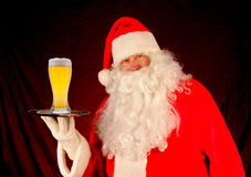 Santa With Glass of Beer on Tray Royalty Free Stock Photos