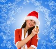 Santa and goblet with champaign. Santa woman and goblet with champaign Royalty Free Stock Photos