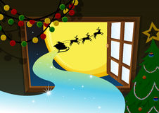 Santa going in reindeer vehicle Stock Photo