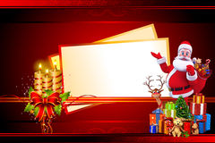 Santa with golden candles and big christmas cards Stock Photography