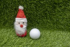 Santa with golf ball on Christmas Holiday royalty free stock images