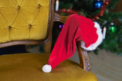 Santa is gone. Santa Claus hat left on the chair close-up Royalty Free Stock Photography