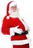 Santa grabbing his belly Royalty Free Stock Photo