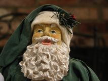 Santa in green suit. Closeup of a Santa Claus figure wearing a green suit Stock Photos
