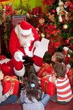 Santa with a group of kids Royalty Free Stock Photography