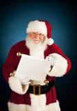 Santa: Guardando a boa e lista má Imagens de Stock Royalty Free