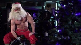 Santa in a gym training biceps 004