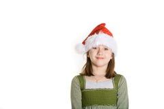 Santa Haat. 8 year old girl in a santa hat Royalty Free Stock Photos