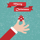 Santa hand with ball. Christmas background with greeting ribbon Royalty Free Stock Images