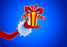 Santa hand with gift Royalty Free Stock Photography