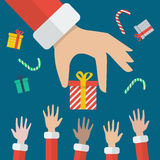 Santa Hand Giving Christmas Gift Box Royalty Free Stock Photos