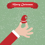 Santa hand with hat. Christmas background with greeting ribbon Royalty Free Stock Images