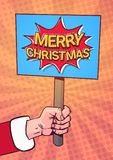 Santa Hand Hold Merry Christmas Banner Pop Art Comic Background Poster Design Winter Holiday Greeting Card Stock Photo