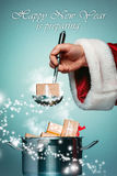 The Santa hand holding a ladle or kitchen spoon Stock Image