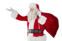 Santa with hand out and holding sack Stock Photos