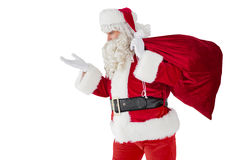 Santa with hand out and holding sack Royalty Free Stock Images