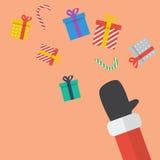 Santa Hand Throw Christmas Gift box Stock Images