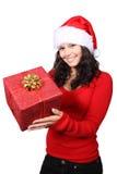 Santa handing a christmas gift Stock Image