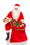 Santa handing out gifts isolated Stock Images