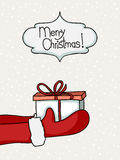 Santa handing present Royalty Free Stock Images