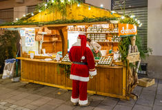 Santa hanging out at the Hot Wine Stall Stock Photo