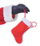 Santa Hanging Stocking with Candy Canes Royalty Free Stock Images