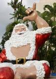 Santa hangs ten Stock Image