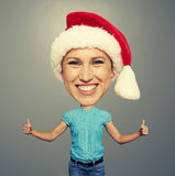 Santa happy girl showing thumbs up Stock Images