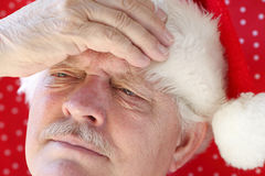 Santa has a bad headache Stock Image